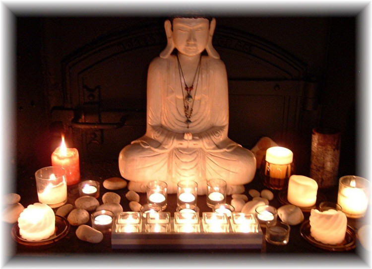 Buddha and candles to heal the world